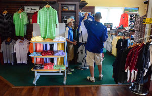 ATS GOLF: Zack Ensor, 15, of Stewartstown Pa., and his dad, Steve shop in the clubhouse pro shop. Tuesday July 9 2013 Twisted Dune Golf Club, EHT. (The Press of Atlantic City / Ben Fogletto) - Ben Fogletto