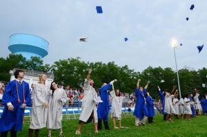 OAKCREST GRADUATION: Students celebrate their graduation from Oakcrest High School in Mays Landing on Monday.  - Photo by Ben Fogletto