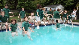 : Bishop McHugh student take a jump into the poll at the McMahon home in Upper Twp. A 20-year tradition that started at St. Augustine School in Ocean City, and is now resurrected at Bishop McHugh in Dennis Twp, students have a pot-luck lunch, and jump in pool in their uniforms on the last day of school. This is the second year the jump has taken place at Anita and Bill McMahon's home in Upper Twp. Friday June 14, 2013. (Dale Gerhard/The Press of Atlantic City)  - Dale Gerhard