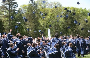 ST. AUGUSTINE GRADUATION: Graduates toss mortars in the air after the diplomas were handed out. The event was held outside on campus. Sunday May 18 2014 St. Augustine Prep Graduation. (The Press of Atlantic City / Ben Fogletto) - Ben Fogletto