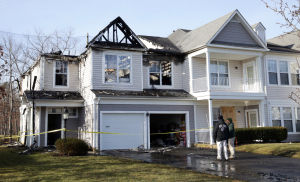 Galloway Townhouse Fire: A fire gutted townhouse is pictured, Thursday Feb. 20, 2014, following an overnight fire at The Woods at Blue Heron Pines community in Galloway Township. (Staff Photo by Michael Ein/The Press of Atlantic City) - Michael Ein