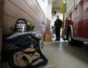 Leveraging The Storm: Ocean City Deputy Fire Chief Jim Smith said flood water from Hurricane Sandy reached nearly three feet inside station Number 2. Lockers were removed, so firefighters keep their gear on the floor or on tables.  - Photo by Dale Gerhard