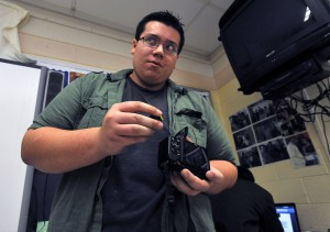 Oakcrest In The Schools: Ryan Baitinger, 17, of Mays Landing, loads a memory card into a camera Thursday during a documentary filmmaking class at Oakcrest High School in Hamilton Township.  - Staff Photo By Michael Ein