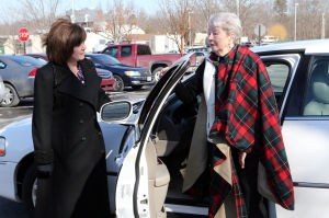 F17 Driver Reeducation: From left, Clare McLaughlin, certified driver rehabilitation specialist, from Glendora, talks with Karen Delgado, a stroke victim from Mays Landing, outside her car at the Bacharach Institute for Rehabilitation, in Pomona, NJ, that was modified to allow her to drive, Tuesday Feb. 11, 2014. - Vernon Ogrodnek