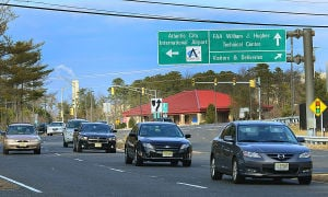 Sequestration: Employee cars leave the FAA Tech facility Monday on Amelia Earhart Blvd. at Atlantic City International Airport, EHT. Workers face potential furloughs if federal sequestration goes into effect March 1.  - Photo by Ben Fogletto