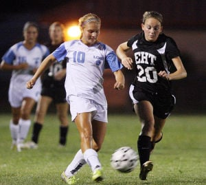 LCM Girls Soccer: Lower's Amanda Durbin (10) advances the ball in front of Ashley Collins (20) of Egg Harbor Twp. Lower Cape May Regional vs. Egg Harbor Township girls soccer played in Lower Cape May. Monday Sept. 09, 2013,. (Dale Gerhard Photo/Press of Atlantic City) - Dale Gerhard