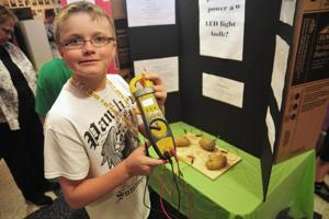 Hess science fair, in its third year, gets 400 fifth-graders to appreciate 'magic'
