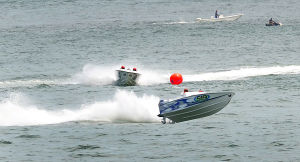 AC Power Boats: Boat 519 navigates a turn during the first race. Sunday June 23 2013 Atlantic City Offshore Grand Prix powerboat race off the beach in Atlantic City. (The Press of Atlantic City / Ben Fogletto)  - Ben Fogletto