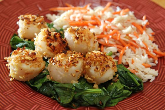 Peanuts and coconut make for crusty scallops