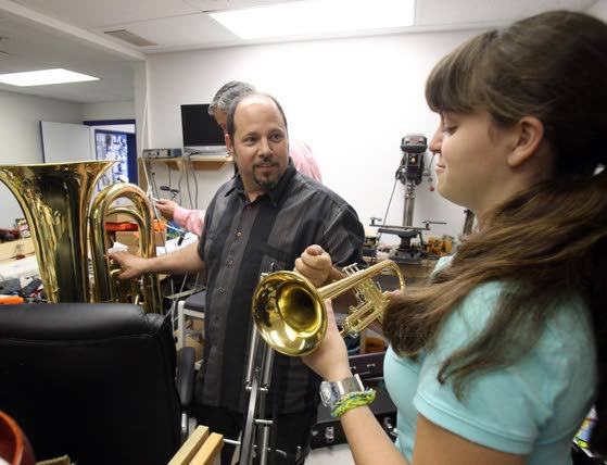 Hitting a helpful noteLinwood teens find new homes for unused instruments to help student musicians