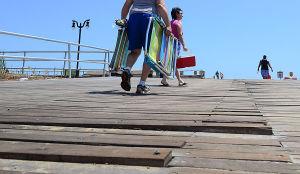 Boardwalk Improvements: Edward and Lisa Jess of Washington Township walk past loose boards on the access ramp at Albany Avenue in Atlantic City. Saturday June 1 2013 (The Press of Atlantic City / Ben Fogletto)  - Ben Fogletto