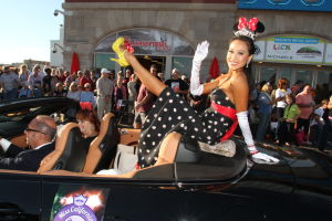 MISS AMERICA PARADE: Miss California Crystal Lee show off her shoe as she waves to during Miss America parade on Atlantic City Boardwalk Saturday, Sept 14, 2013. - Edward Lea