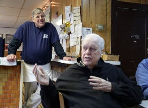 Greasy Spoons: Bob Essl, of Absecon, left, listens to a story told by Lunch Club member Norm Hilton, of Northfield, Wednesday April 30, 2014, at his eatery Essl's Dugout in Egg Harbor Township. (Staff Photo by Michael Ein/The Press of Atlantic City) - Michael Ein