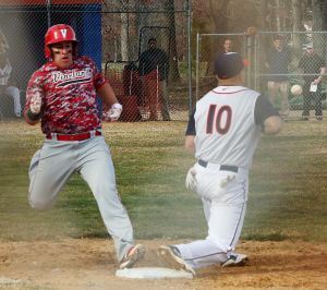 Vineland Vs. Millville Baseball: Vineland's Ivan Rivera #32 beats the tag at first base against Millville's Harry Montero #10 during baseball game at Millville High School Wednesday, April 2, 2014. - Edward Lea