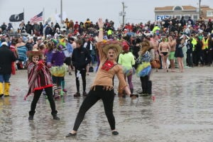 SEA ISLE POLAR PLUNGE: Casey Betsch, 18 of Mount Laurel, NJ take part in Sea Isle City's huge Polar Plunge Saturday,Feb 15, 2014. - Edward Lea