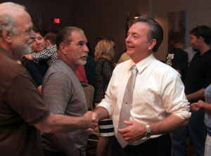 Atlantic County Republican Primary: Atlantic County Executive Dennis Levinson, congratulates, Will Paul, Atlantic County freeholder candidate, after winning Paul's primary bid for freeholder at the Sandi Pointe Restaurant, in Somers Point, Tuesday June 4, 2013. In center is Rich DeFeo, of Mays Landing  - Vernon Ogrodnek