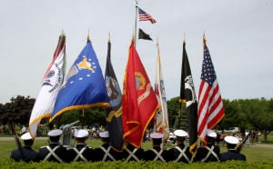 : Members of the U.S. Coast Guard Training Center Cape May, served as color guard during the ceremony. Memorial Day services held at Veterans Cemetery in Crest Haven, Middle Township. Monday May 27, 2013. (Dale Gerhard/The Press of Atlantic City)  - Dale Gerhard
