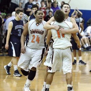 Middle Photo: Middle Township's LaMarr Greer, left, Darrell Shelton (11) and Tom Catanoso, background, celebrate their double-overtime win against St. Augustine Prep on Tuesday at Hammonton High School. At left is St. Augustine's Michael Greenman.  - Edward Lea