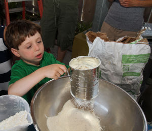 Acbp Y10 Challah Baking Class: Nathan Convissar, 6, of Ventnor, spent the early part of his birthday July 5 learning how to make challah. - Kristian Gonyea