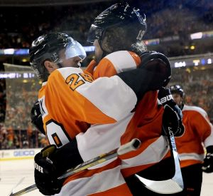 Flyers Photo: The Flyers' Claude Giroux, left,  celebrates with Scott Hartnell after he scored a goal in the second period against the Maple Leafs on Monday in Philadelphia.