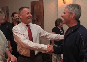 Atlantic County Republican Primary: Franks Balles, left, is congratulated by Alex Marino, of Linwood, on winning the primary bid for state senate at the Sandi Pointe Restaurant, in Somers Point, Tuesday June 4, 2013.  - Photo by Vernon Ogrodnek