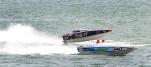 AC Power Boats: Tug It 66 and Pump It 540 on the straight-away during the first race. Sunday June 23 2013 Atlantic City Offshore Grand Prix powerboat race off the beach in Atlantic City. (The Press of Atlantic City / Ben Fogletto)  - Ben Fogletto