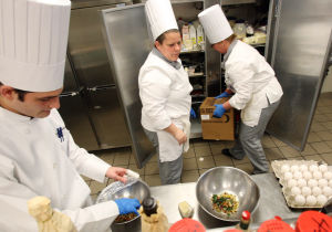 : Culinary students Alex Cotellessa (left) of Philadelphia, Pa, Tracey Donahue of Villas, (center) and Elise D'Alicandro of Wildwood Crest, work in the kitchen during class. The Cape campus of Atlantic Cape Community College in Cape May Court House, now offers a Culinary Arts Training Program. Wednesday April 3, 2013. (Dale Gerhard/The Press of Atlantic City)  - Dale Gerhard