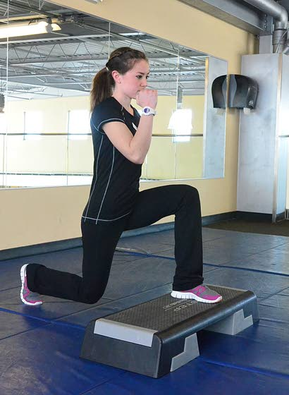 Your Workout: Reverse lunge with high knee