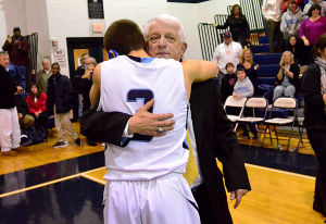 Paul Rodio: SA player 3 Michael Greenman hugs Coach Rodio after the game. Monday February 11 2013 St. Augustine Prep boys basketball coach Paul Rodio records his 776th career win Monday to be South Jersey's all-time winningest coach. The game was played against Lower Cape May Regional at St. Augustine. (The Press of Atlantic City / Ben Fogletto)  - Ben Fogletto