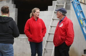 GB A21 LTRG: Home owner Sarah Huff (center) talks with Michael Wimmer Sr. from The Salvation Army at the work site. Tuesday April 8 2014 Volunteers from the county Long Term Recovery Group work on a house owned by Sarah Huff in Brigantine damaged by Hurricane Sandy. (The Press of Atlantic City / Ben Fogletto) - Ben Fogletto