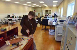 Downtowns In The Velocity Zone: John Pendlebury of Northfield works on renovations inside Marketplace Realty on Ventnor Avenue as employees work at folding desks until the build is complete. Monday February 18 2013 Margate's downtown is right in the middle of a bowl-shaped depression that is part of the proposed velocity zone on the new FEMA flood maps - one of the few in the area to do so. (The Press of Atlantic City / Ben Fogletto)  - Ben Fogletto