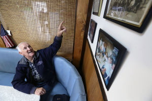 Greasy Spoons: Lunch Club member Bob Nugent, of Northfield, points to a newspaper clipping, Wednesday April 30, 2014, at Essl's Dugout in Egg Harbor Township. (Staff Photo by Michael Ein/The Press of Atlantic City) - Michael Ein