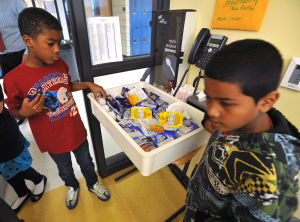 SCHOOL BREAKFAST: Ramer Cook, left, and Chris Garcia, both 9, select breakfast items in class, Monday Sept. 30, 2013, at the Egg Harbor City Community School. The district is among most improved statewide in offering breakfast since they began including it in school day for all children. (Staff Photo by Michael Ein/The Press of Atlantic City) - Michael Ein