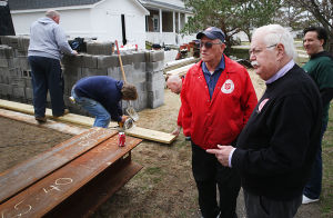 GB A21 LTRG: Michael Wimmer Sr. from The Salvation Army (center) and LTRG Chair Henry Wise (right) at the work site. Tuesday April 8 2014 Volunteers from the county Long Term Recovery Group work on a house owned by Sarah Huff in Brigantine damaged by Hurricane Sandy. (The Press of Atlantic City / Ben Fogletto) - Ben Fogletto