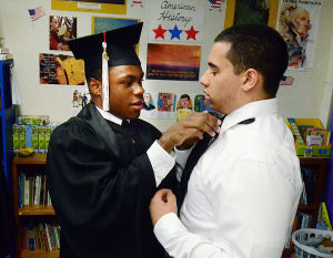 PILGRIM ACADEMY GRADUATION: Graduate Adam Johnson of Mays Landing (left) helps fellow graduate Nigel Anderson of Estell Manor with his tie. Friday May 31 2013 Pilgrim Academy Graduation. (The Press of Atlantic City / Ben Fogletto)  - Photo by Ben Fogletto