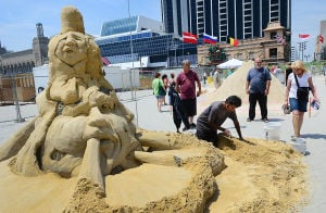 SAND SCULPTING: Sculptor Sudarsan Pattnaik of Puri, India works on his entry. Sunday June 16 2013 World Championship of Sand Sculpting on the beach next to the Pier at Caesars in Atlantic City. (The Press of Atlantic City / Ben Fogletto)  - Photo by Ben Fogletto