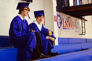 SACRED HEART GRADUATION: Josh Bower of Millville (left0 and Drew Mesiano of Vineland in the gym bleachers before graduation. Monday June 3 2013 Sacred Heart High School Graduation. (The Press of Atlantic City / Ben Fogletto)  - Photo by Ben Fogletto