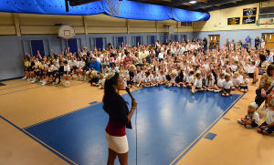 Miss A Visit: Miss America Nina Davuluri talks to the children assembled in the gym. Tuesday October 1 2013 Miss America Nina Davuluri visits St. Joseph's Regional Catholic School in Somers Point. (The Press of Atlantic City / Ben Fogletto) - Ben Fogletto