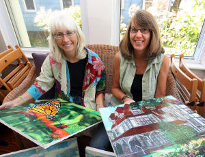 Art Auction: Local artist Janet Payne (left) and Paige Cunningham of West Cape May, have organized a community art auction to benefit local art non-profits in Cape May. Payne and Cunningham display some of the patchwork paintings created that will appear in a children's book titled Cape May A to Z. Friday Sept. 20, 2013,. (Dale Gerhard Photo/Press of Atlantic City) - Dale Gerhard