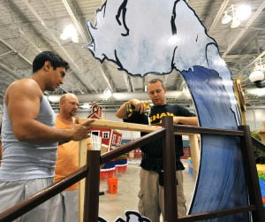 MISS AMERICA PARADE ADVANCE: Marcus Stuart, left, Gene Mumma, and John Shaw, III, all of Frostburg, MD, construct a support for the Catalina Swimwear parade float, Friday Sept. 13, 2013, at the Atlantic City Convention Center ahead of Saturday's Miss America Show Us Your Shoes Parade. (Staff Photo by Michael Ein/The Press of Atlantic City) - Michael Ein