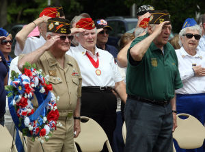 : Veterans salute during the singing of the National Anthem. Memorial Day services held at Veterans Cemetery in Crest Haven, Middle Township. Monday May 27, 2013. (Dale Gerhard/The Press of Atlantic City)  - Dale Gerhard