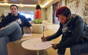 Do Ac Auditions: Applicants Jerry Ryan of Smithville (left) and Rashada Ellis of Atlantic City fill out forms while waiting for the interview. Friday April 5 2013 Auditions to represent Atlantic City as an 'brand ambassador' on the 'Do Crew' held at Revel, Atlantic City. (The Press of Atlantic City / Ben Fogletto)  - Ben Fogletto