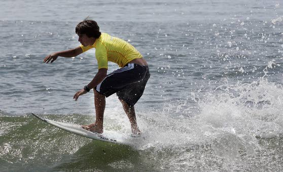 Scores of surfers score big despite uncooperative waves