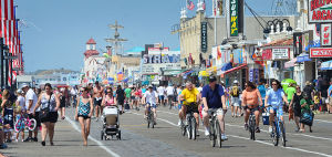 JL08 Holiday Weekend: People ride bikes and walk near 7th Street in Ocean City on the Boardwalk. Sunday July 7 2013 4th of July Weekend in Ocean City. (The Press of Atlantic City / Ben Fogletto) - Ben Fogletto