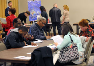 CUMBOVETS: Job seekers complete application forms, Wednesday March 20, 2013, during a Veterans Job Fair at Cumberland Community College in Vineland. (The Press of Atlantic City/Staff Photo by Michael Ein)  - Michael Ein