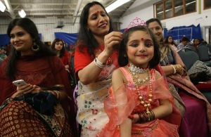 Vaisakhi: Monday April 14 2014 Chapa Chowdhury of Atlantic City (center) fixes the hair of her daughter, Soptorshi, 4, while waiting for the Boisakhi festival to begin at Howard Johnsons in West Atlantic City. (The Press of Atlantic City / Ben Fogletto) - Ben Fogletto