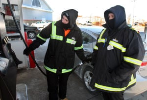 : Gas station attendants Kevin O'Brien of Wildwood, (left) and Gary Seabridge of North Cape May, bundle up during the work day attending to cars at Wawa in Rio Grande. Wednessday Jan. 23, 2013. (Dale Gerhard/Press of Atlantic City) - Dale Gerhard