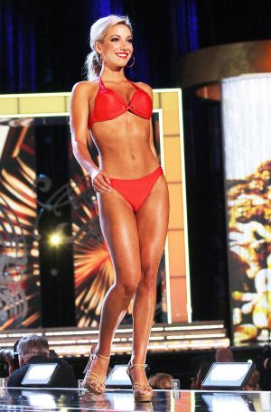 Miss America 2 PRELIMS: Miss New Jersey, Cara McCollum contestant walks the runway during swimsuit portion of the preliminary second round of the Miss America pageant at Boardwalk Hall in Atlantic City, New Jersey, September 11 2013 - Photo by Edward Lea