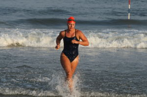 Women Lifeg: Ocean City's Holly Berenotto places first in Row / Swim race during Ocean City Beach Patrol Women's Invitational Wednesday, July 24, 2013. - Edward Lea