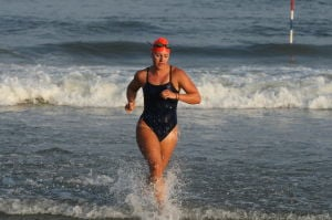 Women Lifeg: Ocean City's Holly Berenotto places first in Row / Swim race during Ocean City Beach Patrol Women's Invitational Wednesday, July 24, 2013. - Photo by Edward Lea